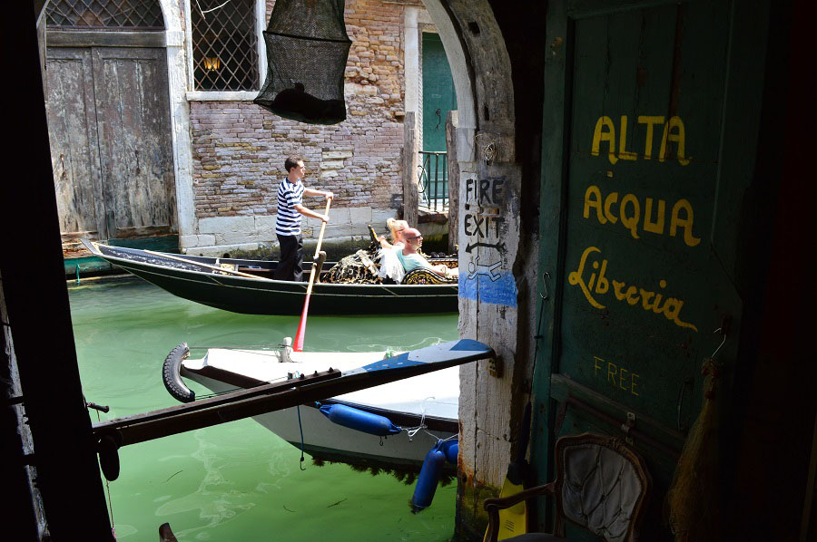 Acqua Alta Bookstore and a Gondola