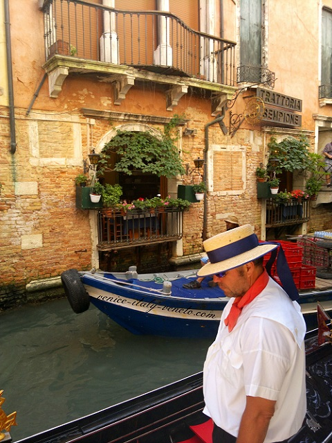 The sad gondolier in Venice Italy