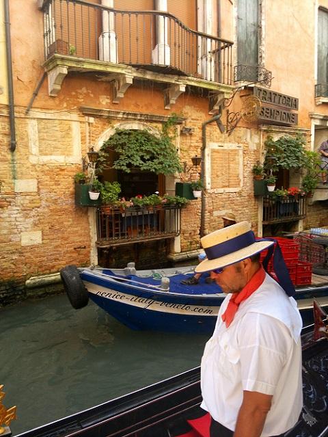 The sad gondolier in Venice Italy
