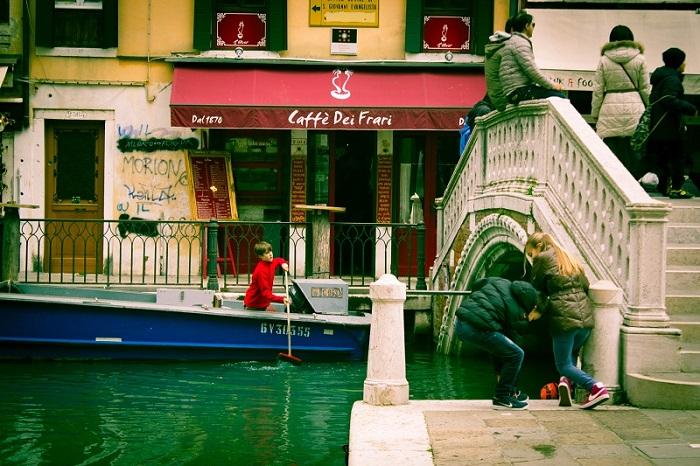 Boy in Boat Venice