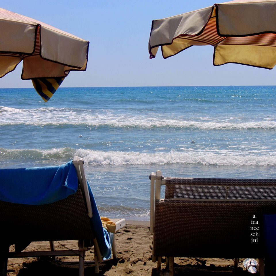 Deck chairs on the beach in Tuscany