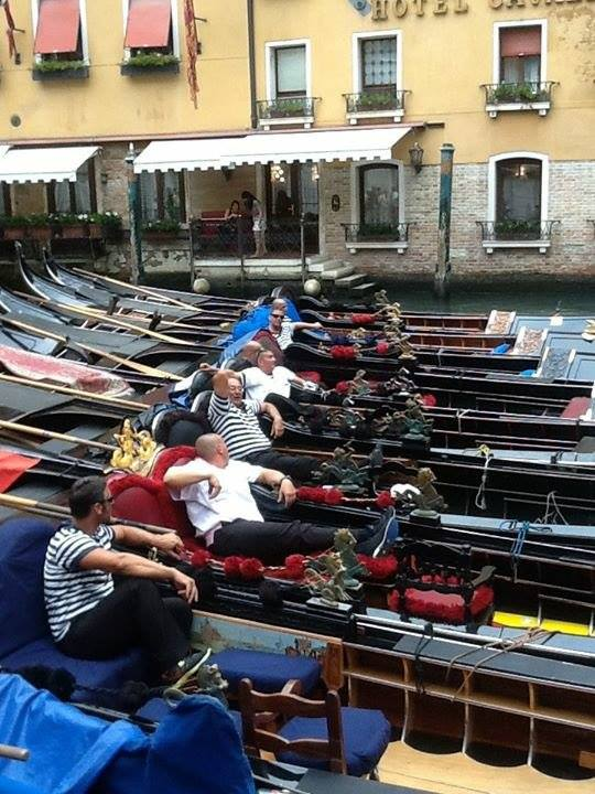 Gondoliers in a row relaxing by Paul Battinieri