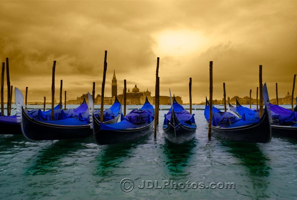 Gondolas in Venice by Jim DeLutes