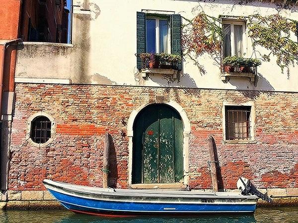 Blue boat on Venetian Canal